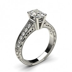 Oval White Gold Side Stone Engagement Rings