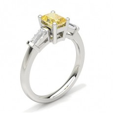 Bague 3 pierres diamant jaune emeraude/baguette serti rail