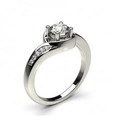 Bague 3 pierres épaulée diamant rond/Baguette/princesse serti 4 griffes