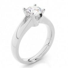 Bague en diamant solitaire épaulé diamant emeraude/rond serti 4 griffes et rail