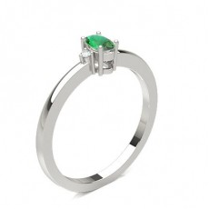 Prong Setting Emerald Side Stone Ring